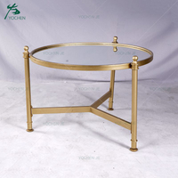 Wrought iron coffee table with round glass top